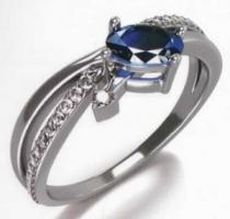 Agata prsten z bílého zlata posetý 25ks diamanty a modrým safírem